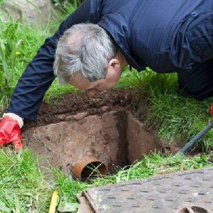 Inspecting a drain manhole